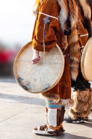 Folk ensemble performance in dress of indigenous people and tambourine of Kamchatka.