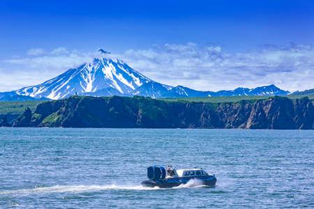 Hovercraft on Pasific ocean in kamchatka Peninsula on the background volcano Imagens - 127394407