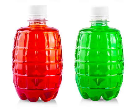 Colored drink in plastic bottle on white background