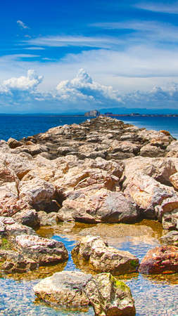old stone pier in the sea, Spain Imagens