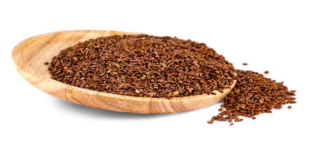 Flax seeds in a wooden plate isolated on a white background Imagens
