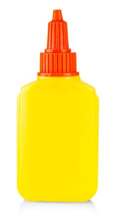 Yellow tube of glue isolated on white background