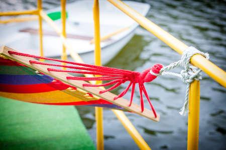 backyard rope hammock held by metal railing