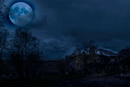 The blue Haunted House with Full Moon.