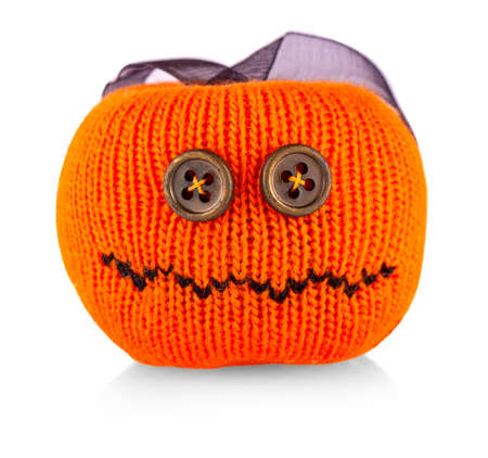 toy knitted pumpkin on Halloween on white Banco de Imagens