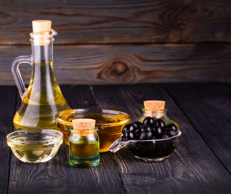 small bowl and bottle with olive oil Reklamní fotografie