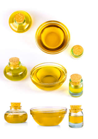The glass bottles with oil isolated on white background