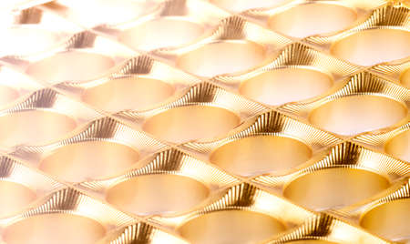 shiny gold plastic background as texture of the empy candy box Stok Fotoğraf - 131824070
