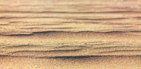 The closeup of sand pattern of a beach in the summer Stok Fotoğraf - 132447086