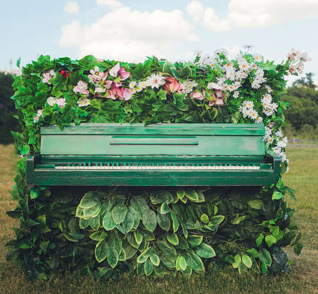 the old piano in beautiful flowers. Select focus Stok Fotoğraf - 132303169