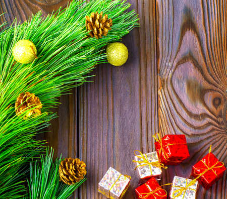 The fir-tree with toys and gifts on wooden Stok Fotoğraf - 132547004