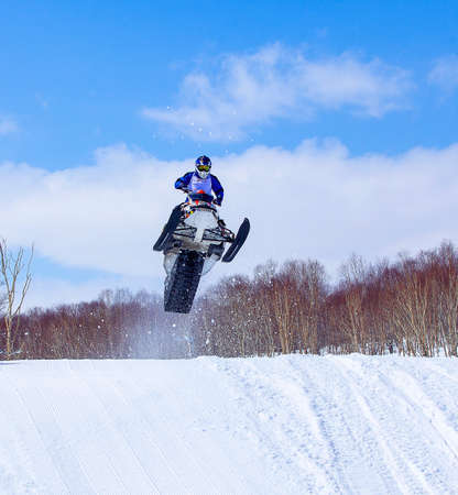 The Snowmobile in high jump above track.