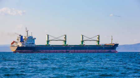 The bulk cargo ship to harbor quayside Vladivostok