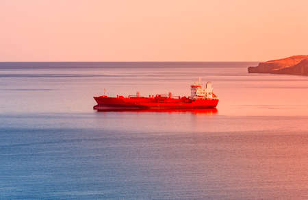The tanker in the blue sea on sinset Stok Fotoğraf