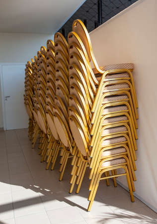 The folding office chairs near the wall
