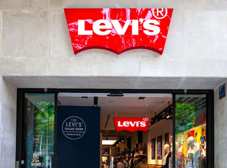Barcelona, Spain - Jine,06, 2019: entrance to Levi. Levi s is an American maker and retailer of denim clothing