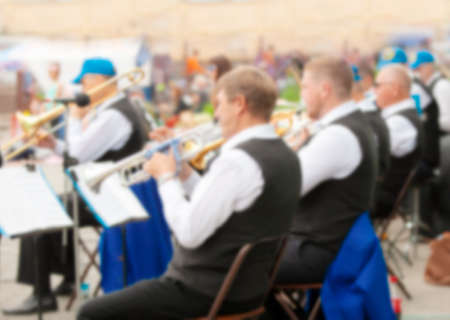 The urban instrumental orchestra blurred as the background