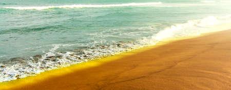 The Shiny tropic sea wave on golden beach sand Stok Fotoğraf