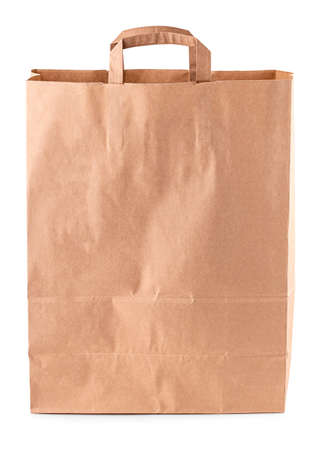 The brown paper bag on a white background. concept of rejection of plastic bags. close-up Stok Fotoğraf