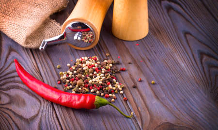 The Black pepper corns, red hot chili pepper and Black pepper Powder on wooden background Stok Fotoğraf