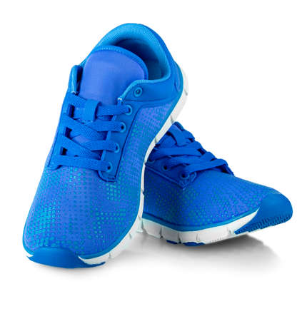 The Pair of blue fashions women sneakers isolated  on white Stock fotó