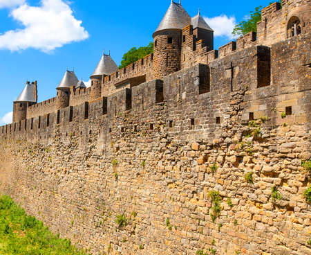 the Medieval stone fortress wall view. France