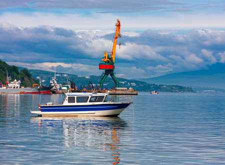 The small boat at the seaport of the Kamchatka Peninsula