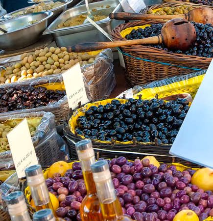 The  olives on provencal street market in Provence, France. Selling and buying.