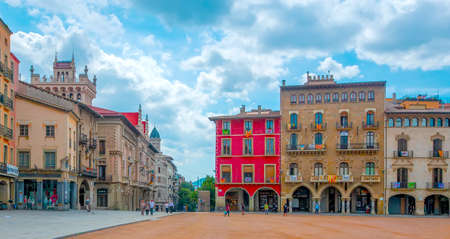 Vic, Spain - 20 JUNE, 2018: The Plaza Mayor in Vic on a sunny day filled with tourists, Catalonia, Spain