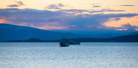 The fishing ships at sunset in the Avacha Bay on the Kamchatka Peninsula Stok Fotoğraf