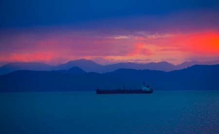 The transport ship at sunset in the Avacha Bay on the Kamchatka Peninsula Stok Fotoğraf