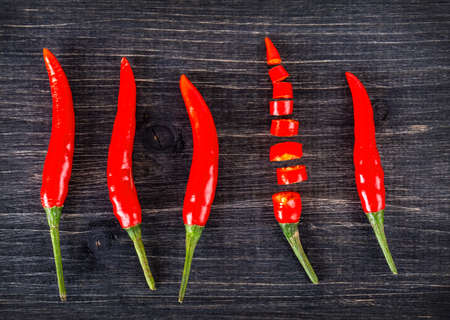 top view of spicy red chili pepper on wooden surface.Selective focus