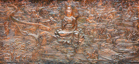 Old bronze relief in buddhist temple in China