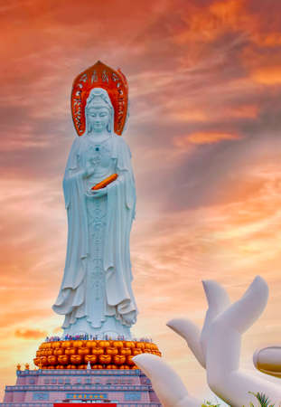 The White Guan Yin statue in Nanshan Buddhist Cultural Park in sunrise, Sanya, Hainan Island, China. Selective focus
