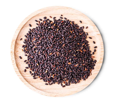The black rice on white background. Selective focus