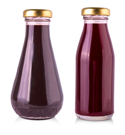 The glass bottles with dark sauce on a white background Stock Photo