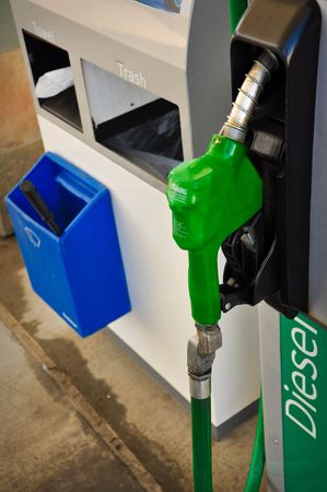 pollutant: Diesel or Gas Fuel Station with Green Pump Handle