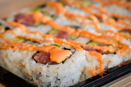 Delicious Fast Food Sushi being served for Lunch or Dinner Stock Photo