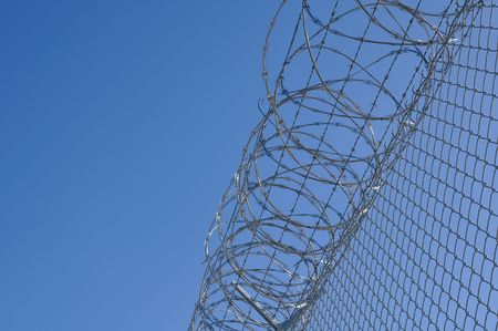 Security Fence used at a Prison Facility with room for text Stock Photo - 6009232
