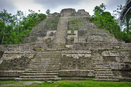tourism in belize: Mayan Temple Deep in the Central America Rain Forest Stock Photo