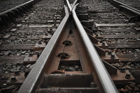 railroad track: Railroad Tracks corssing and going in different directions