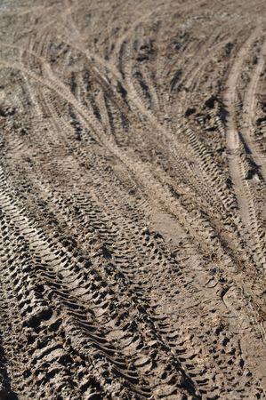 Mountain Bike Tracks in Mud Background Banco de Imagens