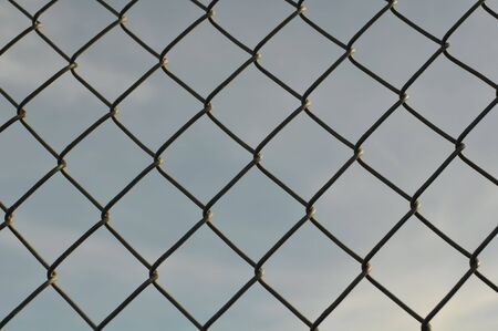 Chain Link Fence Background with Blue Sky