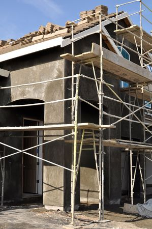 Vertical Angle of New Home Construction with scaffolding photo