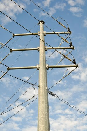 Power Line with Blue Sky and White Clouds