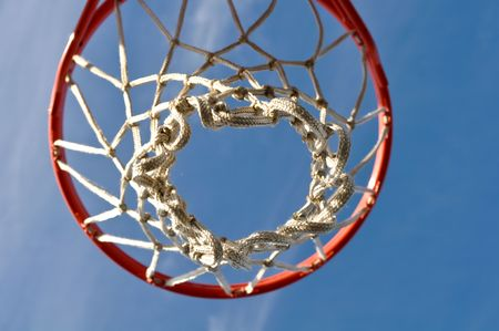 Outdoor Basketball Hoop Close Up with Clouds and Blue Sky Stock Photo - 6780582