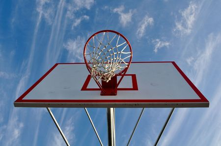 Outdoor Basketball Hoop Close Up with Clouds and Blue Sky Stock Photo - 6780587