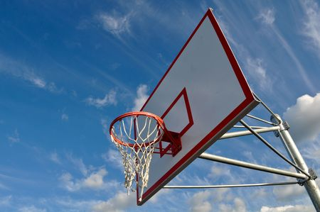Outdoor Basketball Hoop Close Up with Clouds and Blue Sky Stock Photo - 6780588