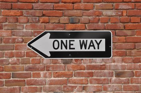 Brick Wall with Black and White One Way Sign Stock Photo - 7019384