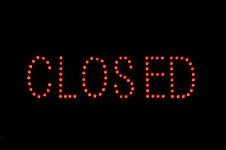 Closed Red Neon Sign with Black Background